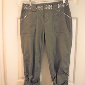 Army green capris with silver studs.